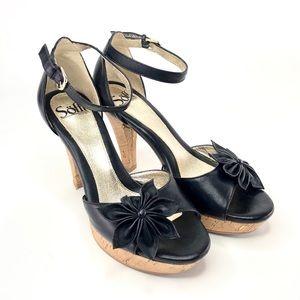 Sofft black wooden heeled shoes flower detail